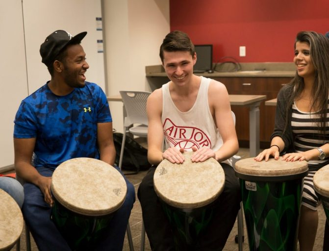 students in drum circle in classroom