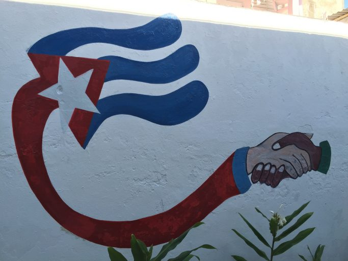 A wall mural in Cuba promoting partnerships. (Photo by Oliver McSurley)
