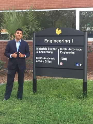 Alex Chavez, a junior majoring in mechanical engineering standing in front of the ucf engineering 1 building