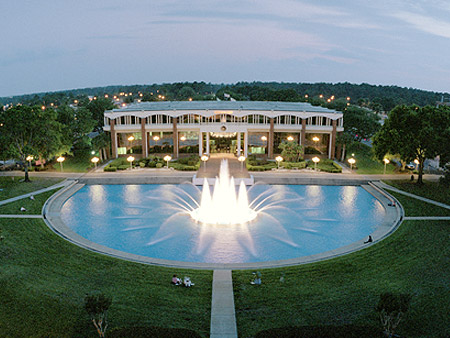 aerial shot of millican hall and ucf reflecting pond with fountain on and lit up
