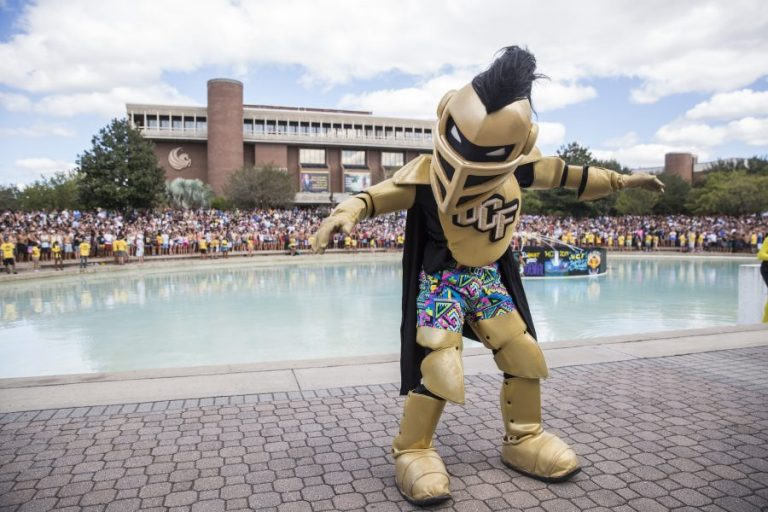 knightro amping up students for spirit splash in front of reflecting pond at ucf