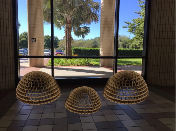 Three domes created by student Savannah Kloess from disposable coffee cup sleeves will be on display in the Visual Arts Building.