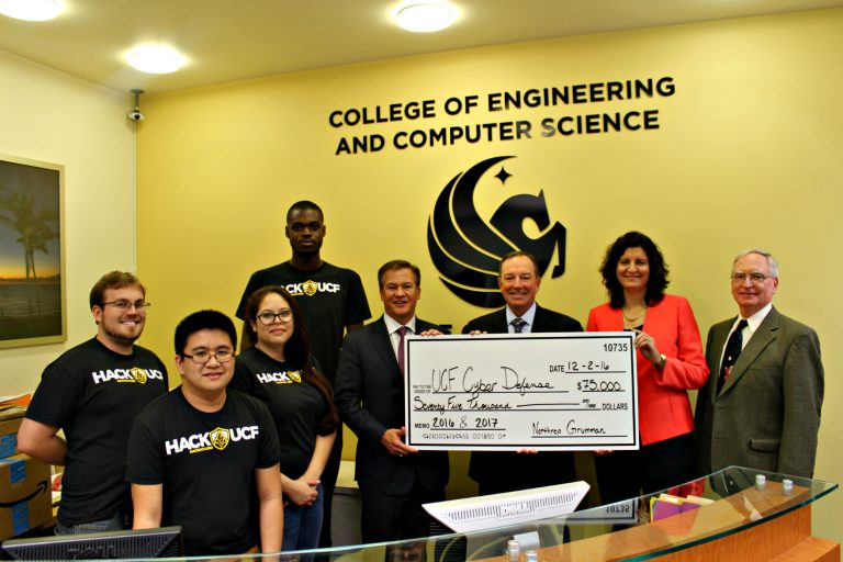 Executives from Northrop Grumman present a sponsorship check to UCF's Collegiate Cyber Defense Club.