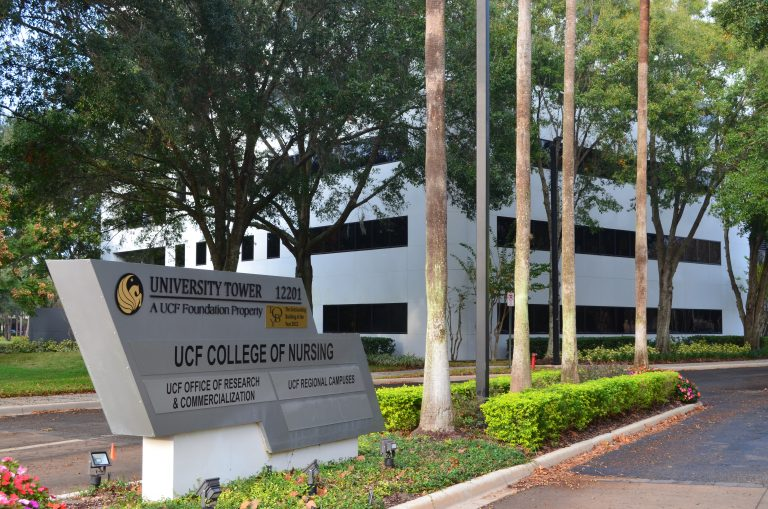 ucf college of nursing sign in front of building
