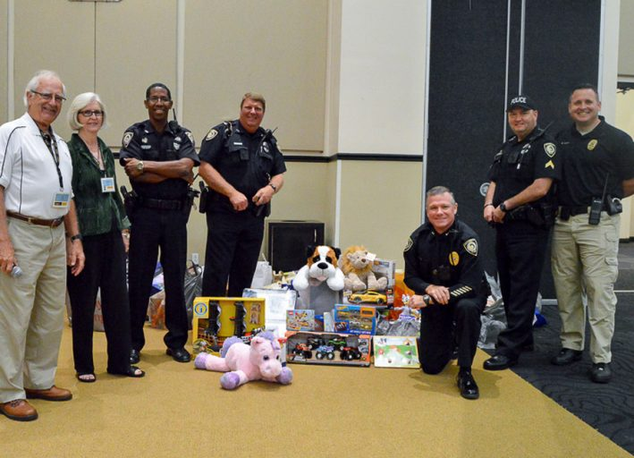 The Learning Institute for Elders, or LIFE, collected donations for Toys for Tots that the UCF Police Department is storing until the university makes its drop off.