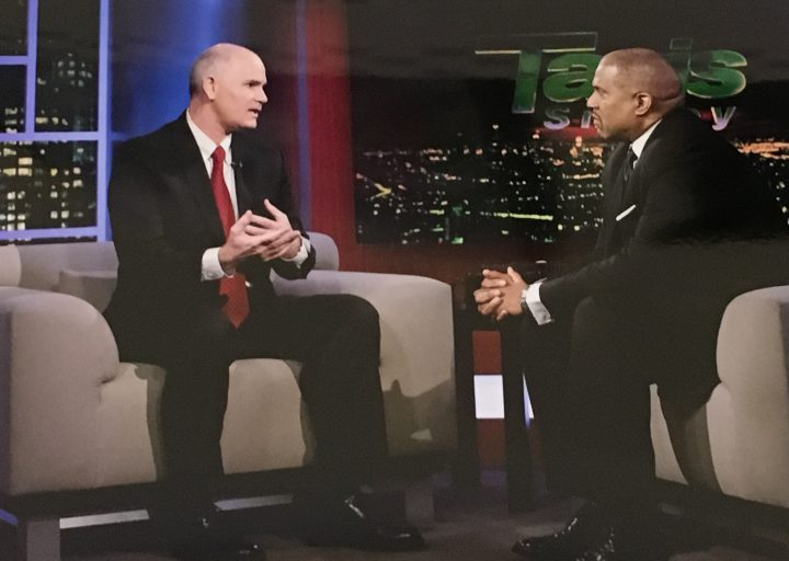 UCF's Thomas Cavanagh explains the university's distributed learning to TV host Tavis Smiley.