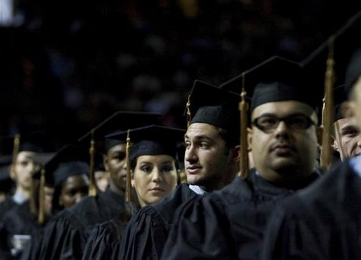 students at graduation, waiting to go on stage