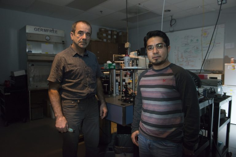 Pegasus Professor Aristide Dogariu, left, and doctoral student Jose Rafael Guzman-Sepulveda have developed a real-time blood monitor that's been tested during open-heart surgery on infants.