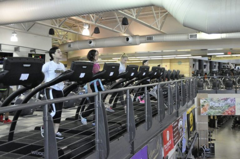 students on cardio machines in ucf rec and wellness center