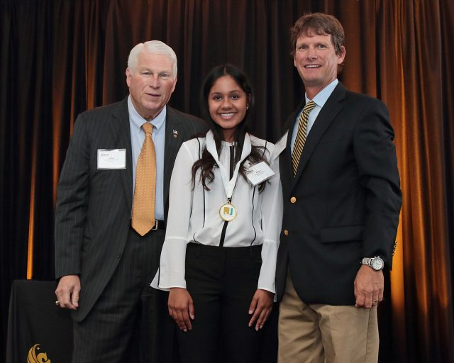 UCF student Kiana Boodram was recognized as a 2016-2017 Johnson Scholar by Bobby Krause of the Johnson Scholarship Foundation and UCF President John C. Hitt at a February 22 ceremony on the UCF campus.