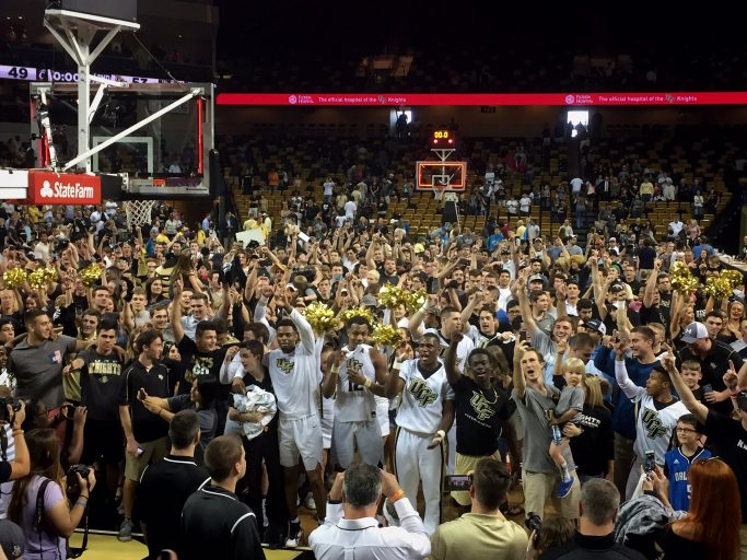 Knight fans charged the court after UCF's victory over No. 15 Cincinnati at CFE Arena Sunday.