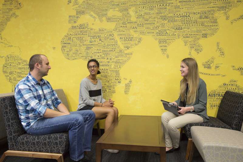 Hollinger, right, meets with Student Sustainability Advisory Committee members to discuss their proposals.