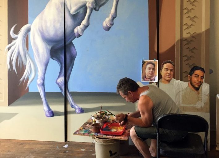 """A mural designed by artists Michael Pilato and Yuriy Karabash features UCF student Juan Ramon Guerrero and two-time alumnus Christopher Andrew """"Drew"""" Leinonen, whose lives were taken at Pulse."""