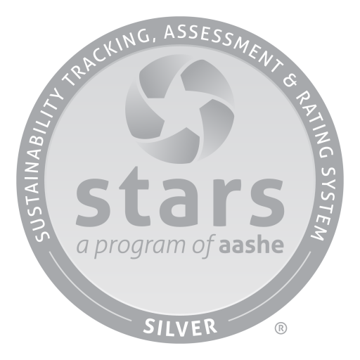 """Stars logo: round silver seal with the words """"stars a program of aashe"""" in the middle and the words """"sustainability tracking, assessment & rating system — silver —"""" arched around the seal"""