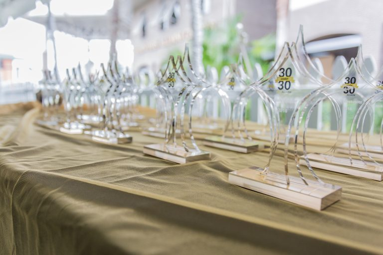 table with gold tablecloth and wine glasses set out