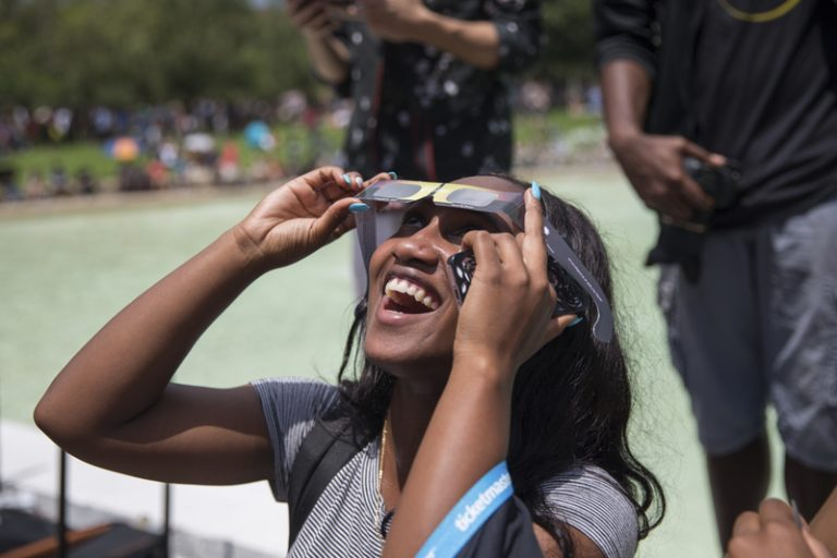 student with solar eclipse glasses at Solar Eclipse Viewing session