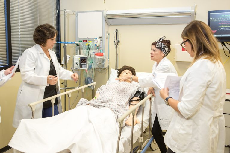 UCF nursing and healthcare simulation students in the STIM Center at UCF College of Nursing.