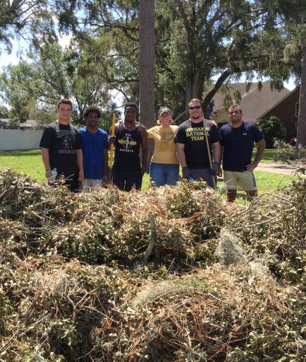 UCF Wrestling Club members spent several days in several neighborhoods cleaning up.