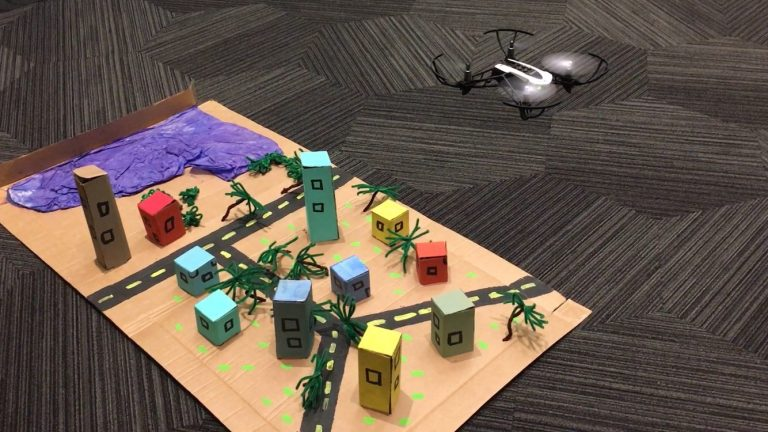 Students flew a mini drone over a model town to simulate how GIS professionals fly drones over land to capture images of pre-and-post natural disasters, shoreline changes over time, and more.