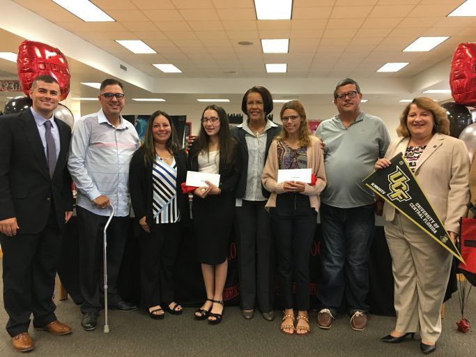 Yerianne Roldan and Zuleyka Avila, in the center with Orange County Public Schools Superintendent Barbara Jenkins, after being surprised with scholarships to Valencia College and UCF.
