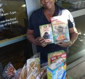Christine Pugh Helps Fill Shelves at Knights Pantry