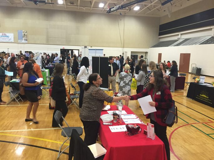 people shaking hands at career fair
