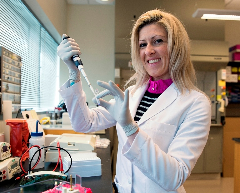 Feed image for Medical Researcher Earns Ph.D., Stays At UCF To Continue Finding Cancer Cure