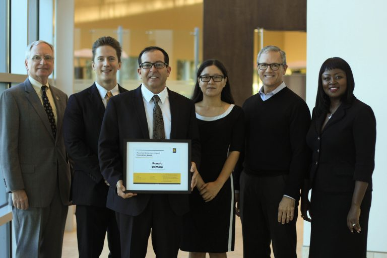 Ronald DeMara (third from the left) is the Fall 2017 Marchioli Collective Impact Innovation Award winner for developing a college-wide testing and tutoring center that's helping students learn better.
