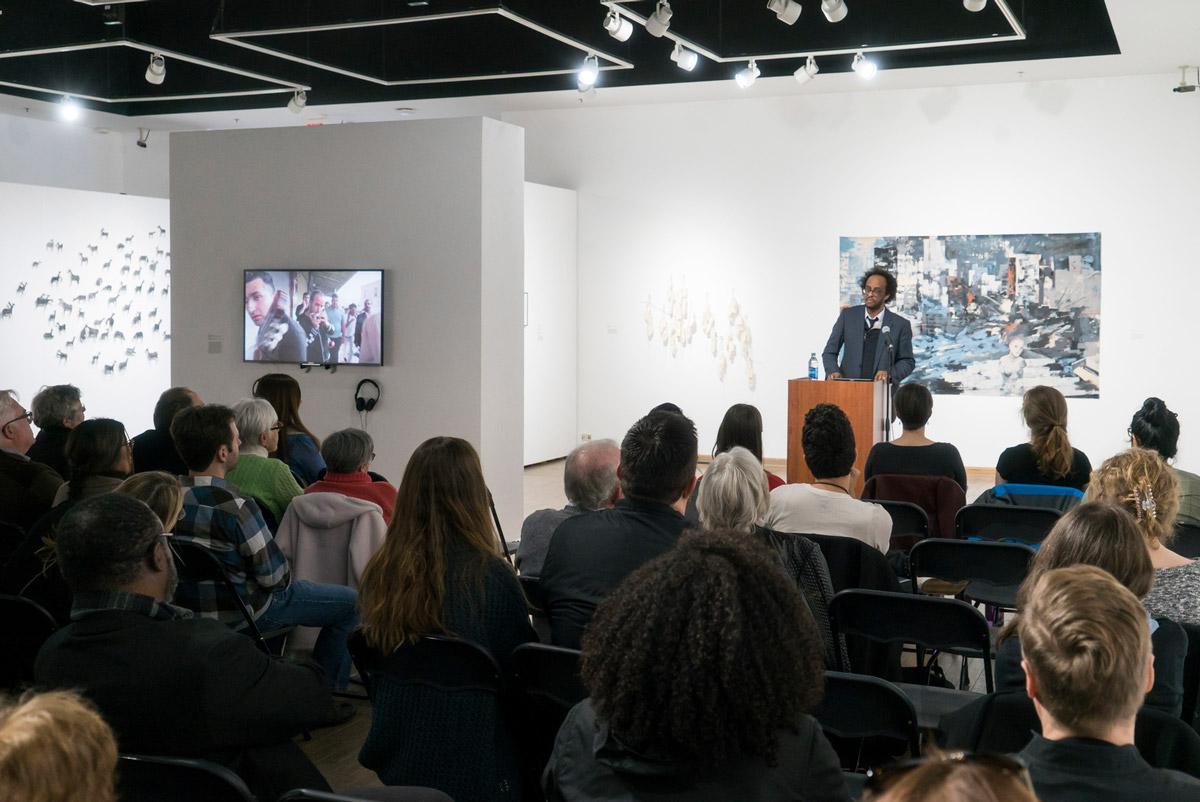 Mengestu spoke at the UCF Art Gallery, where the exhibit Finding Home: The Global Refugee Crisis is on display through Feb. 2. (Photo by Bernard Wilchusky '18)
