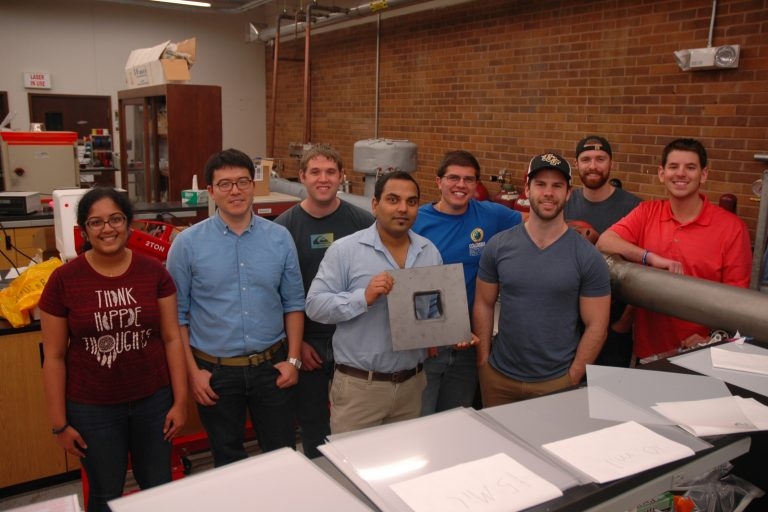 assistant professor of mechanical and aerospace engineering works with his student research team testing next-generation fuels to find out which ones are actually better for cars and the planet
