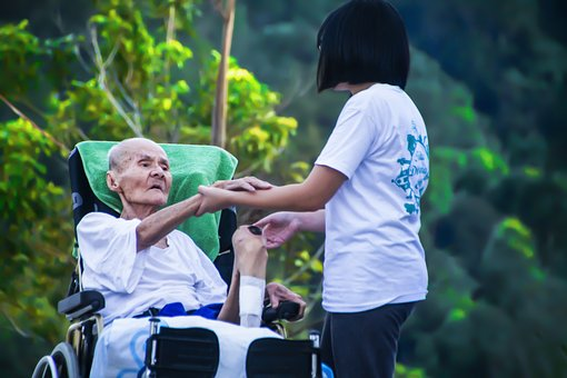 Caregiver taking care of an elderly patient