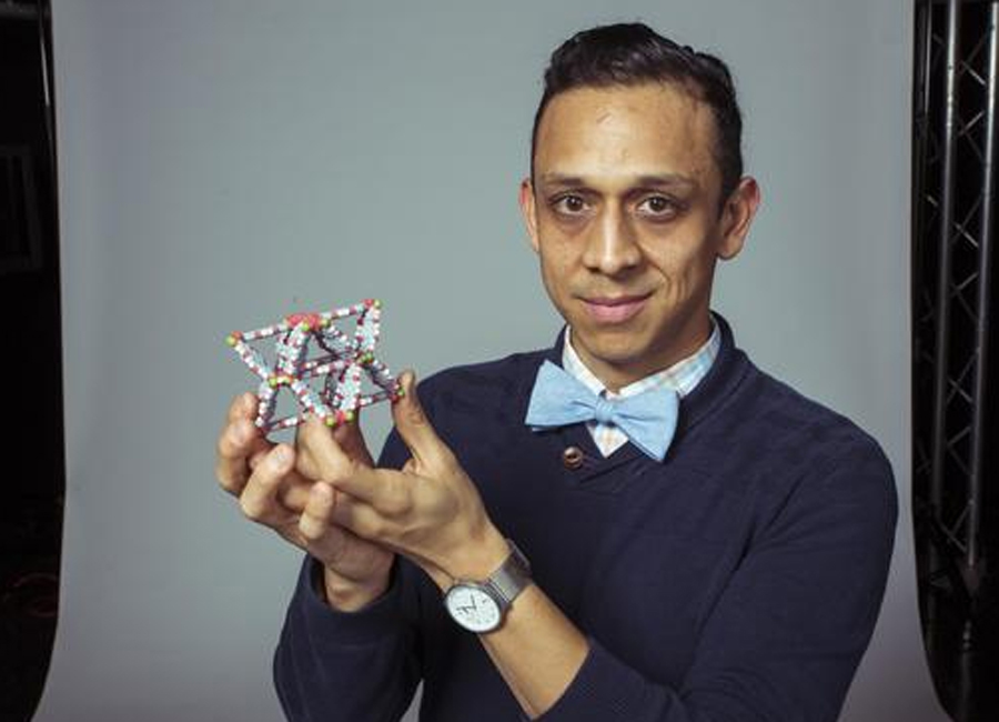 Fernando Uribe-Romo holding up toy invention