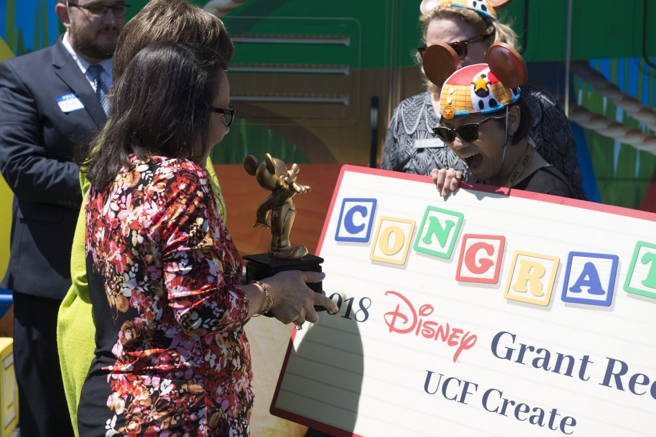 During a special ceremony, Disney presented UCF CREATE Director Stella Sung with a Mickey Mouse trophy in recognition of the $100,000 grant being awarded to the university.