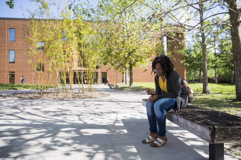 The Education Complex's courtyard is a quiet area to listen to music and enjoy the weather.