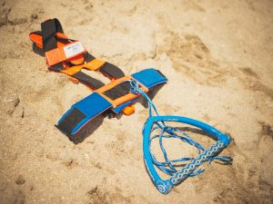 """new piece of beach gear called the """"Skimvest."""" It allows the wearer to run along shallow water while towing a person behind on a skimboard."""