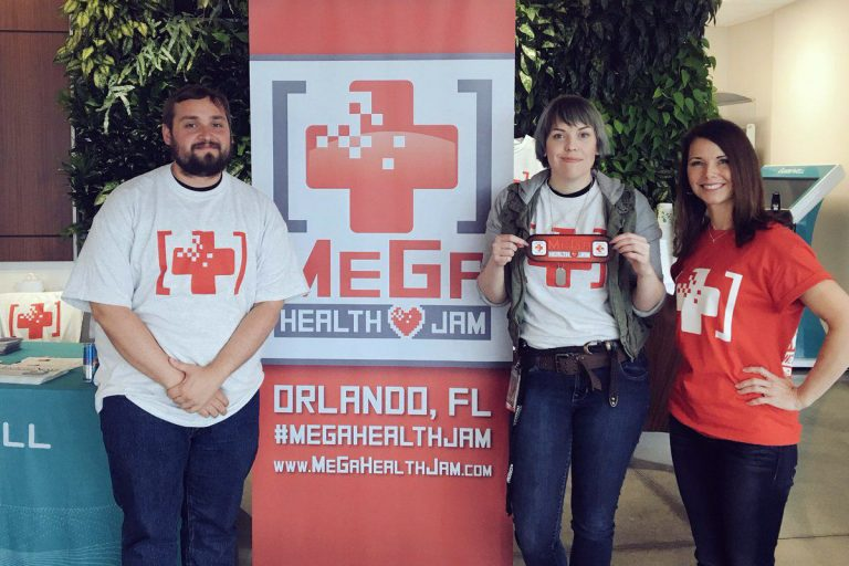 During the inaugural MeGa Health Games, organized by Kelli Murray (right), interactive entertainment master's program students Christine Wright and James Gaiser won first place for their app that aims to improve doctors' visits. (Photo courtesy of MeGa Health Jam)