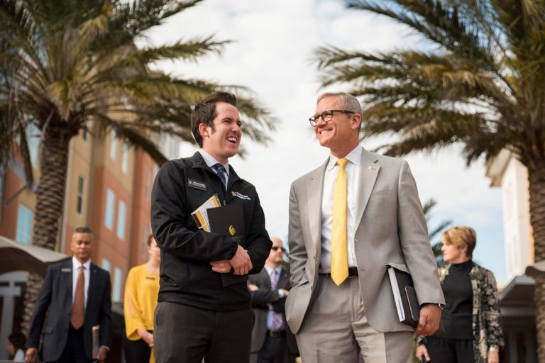 President-elect Dale Whittaker (right) speaks with Tyler Schwaegler, coordinator for residence life and education, during a tour of the UCF campus. (Photo by Nick Leyva '15)