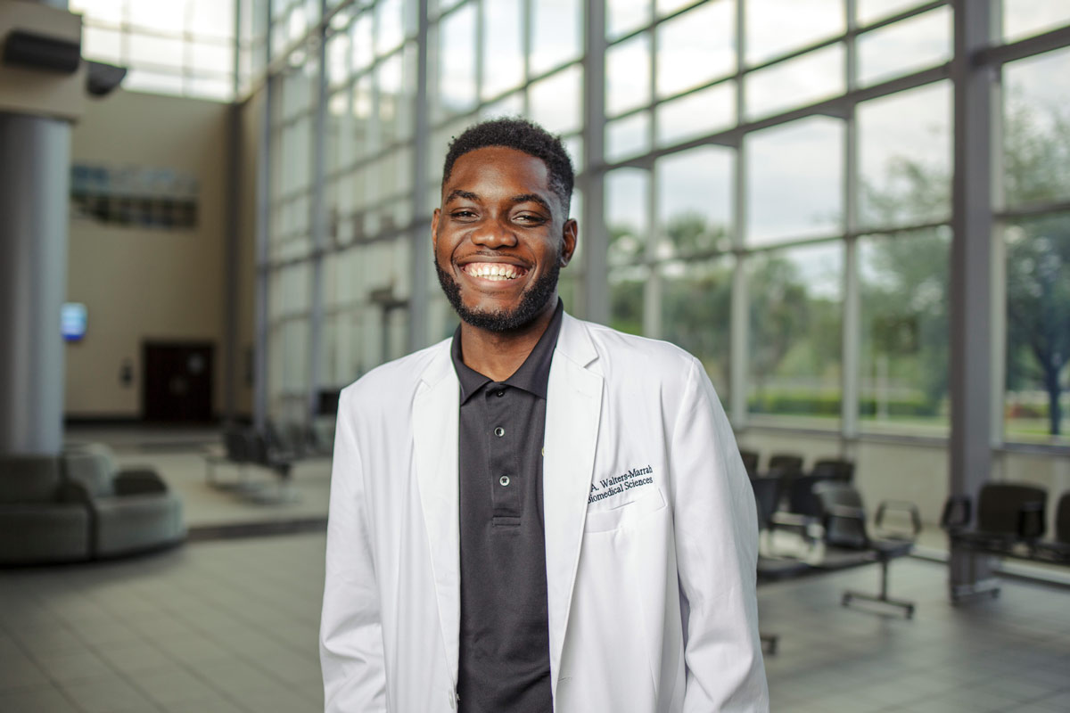 George Walters-Marrah is a junior biotechnology and molecular microbiology major at UCF. (Photo by Steven Diaz)