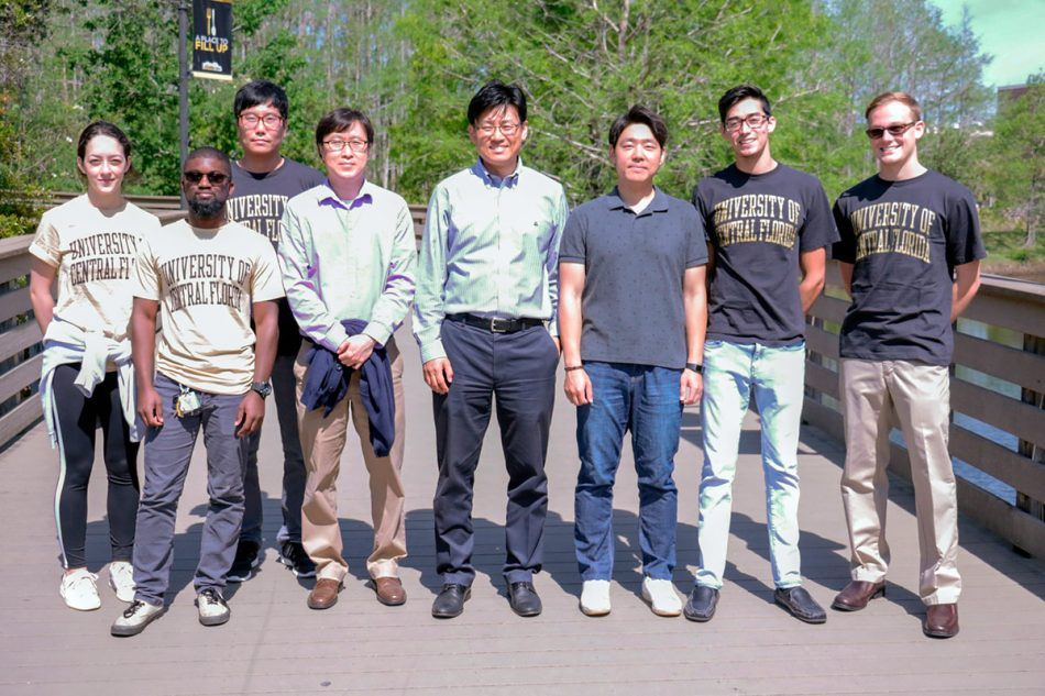 UCF Professor Woo Hyoung Lee and the team of students who developed the sponge. (Photo by Karen Norum)