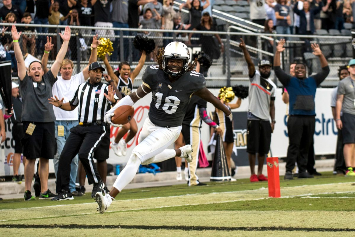 Griffin returned a fumble for a 20-yard touchdown against Austin Peay. The play helped to secure UCF's 73 – 33 defeat over the Governors. (Photos by Nick Leyva '15)