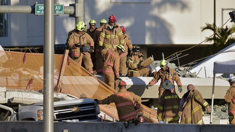 Miami-Dade Fire Rescue firefighters respond to a 950-ton pedestrian bridge under construction that collapsed March 15. (Photo by Michael Laughlin, South Florida Sun Sentinel)