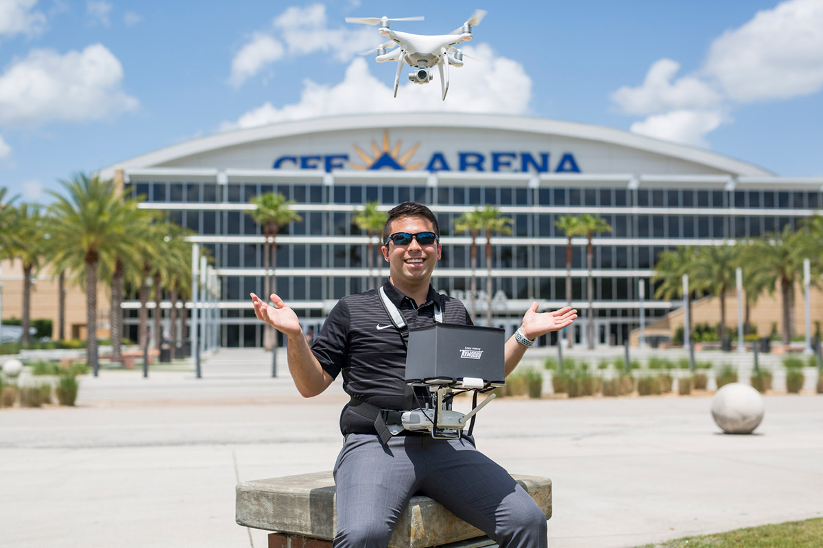 As an intern for UCF's Department of Security and Emergency Management, sophomore Michael Feinman uses his drone to help advance security on and off campus. (Photo by Bernard Wilchusky '18)