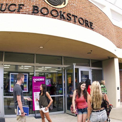 students in front of bookstore