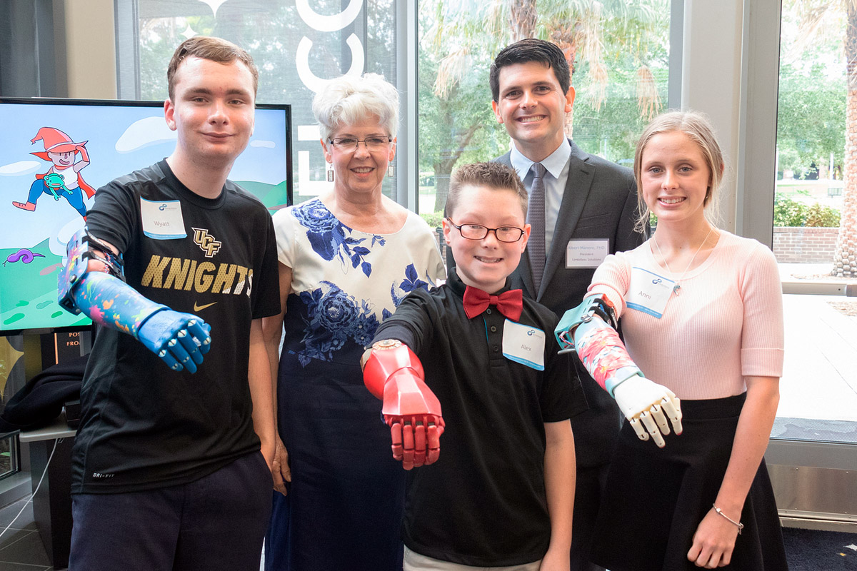 Anne Smallwood (second from left) is providing UCF-based Limbitless Solutions a big gift.
