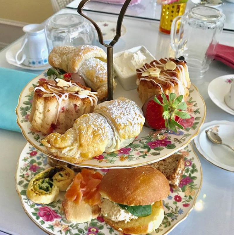 The Pixie —chef's selection of assorted savory and sweet items, served with a traditional biscuit scone and cream and a pot of tea of your choice.