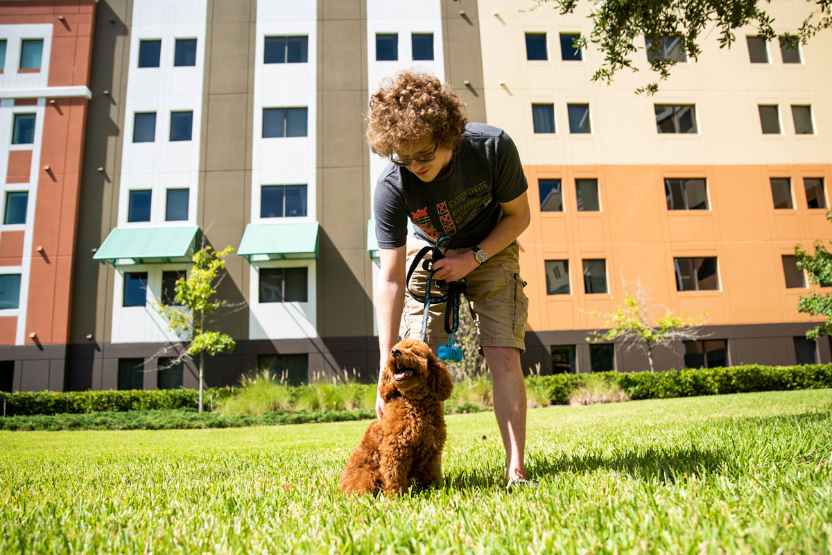 photo of UCF student and his dog