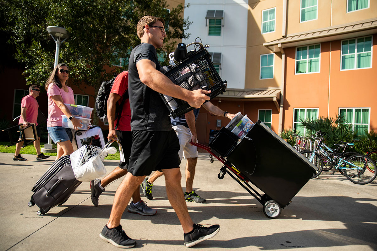 Photo of students moving into dorms