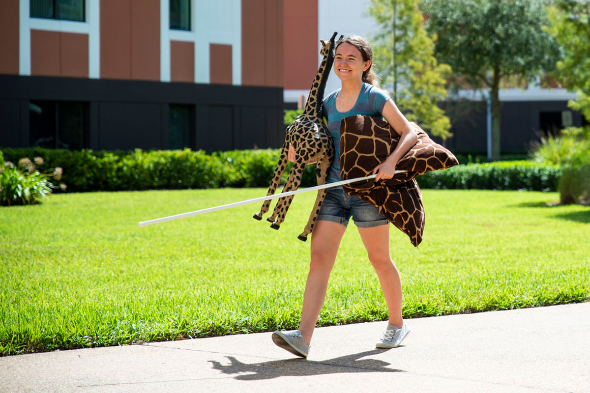 UCF student carrying stuffed animals