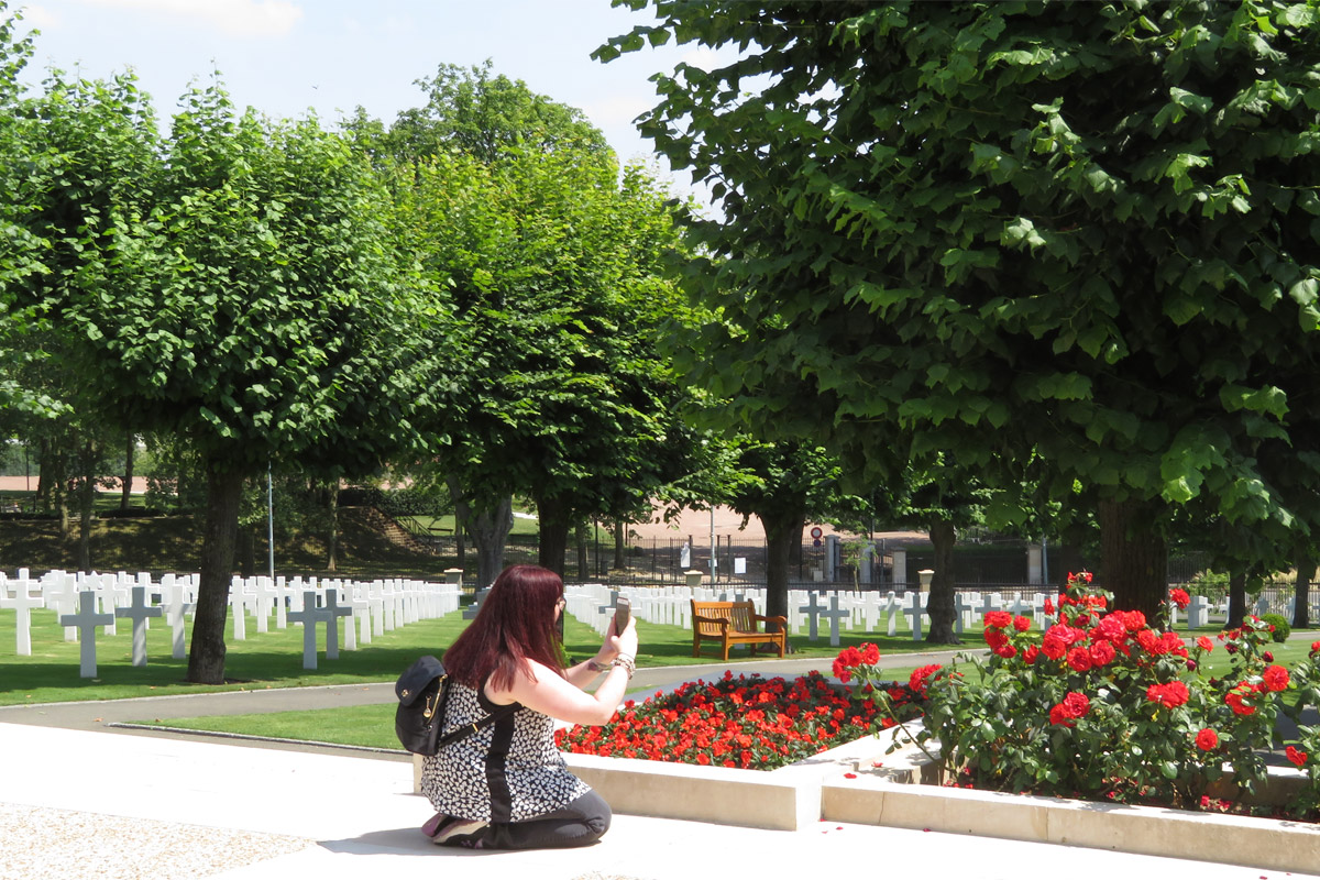 Graduate history student Kayla Campana '15 takes photos at the Suresnes American Cemetery near Paris, France, as part of the UCF Veterans Legacy Program team.