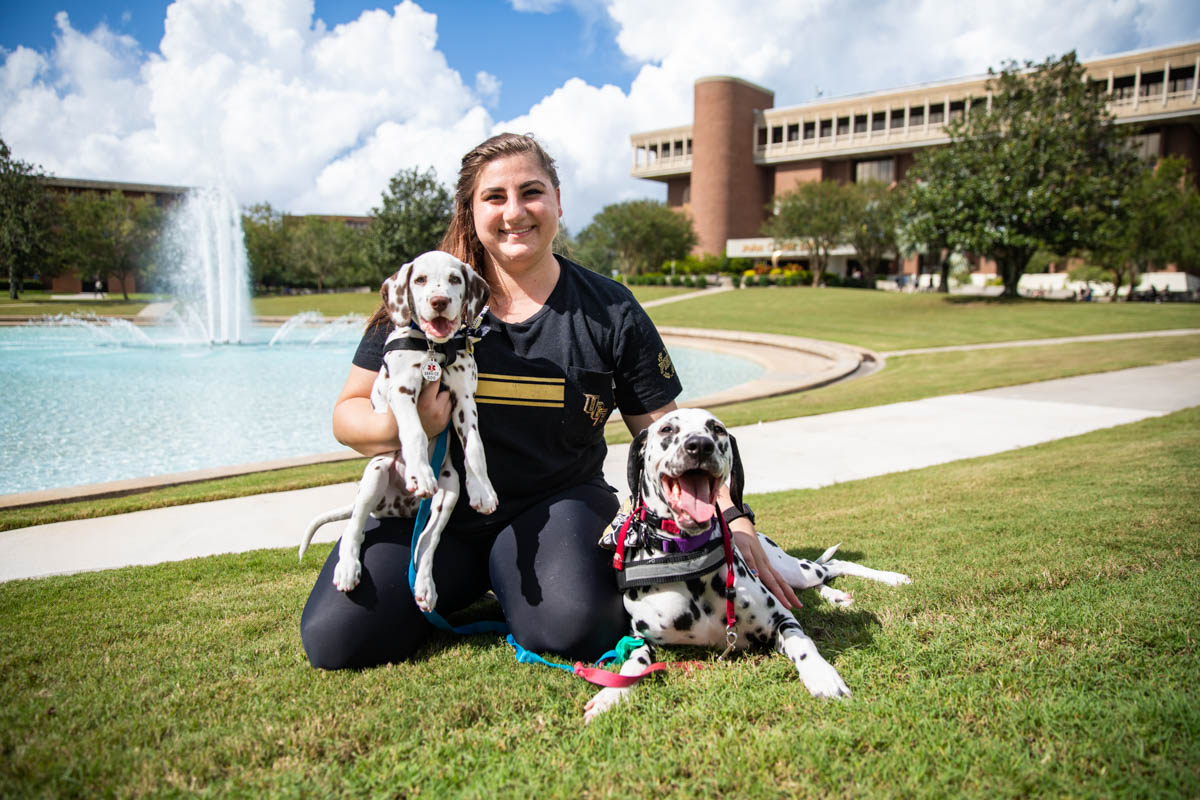 Master's student Casey Bruno '18 brings her service dog Paisley and new puppy Chevron to campus to help her new family member get use to being at UCF. (Photo by Nick Leyva '15)